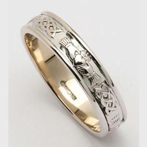 Narrow Celtic Claddagh Wedding Rings. I like the color and the overall form with the celtic knots. but i would love a little stone where the heart is and then maybe small stones on either side of the knots.