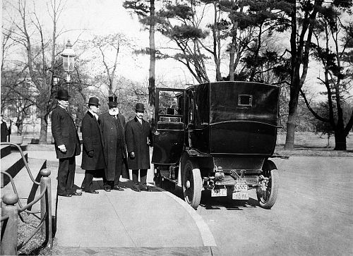 February 10, 1910: The Wright brothers stood outside the Smithsonian Institution Building (The Castle) after receiving the Langley Medal for Aerodromics. Pictured (L to R): Smithsonian Secretary Charles D. Walcott, Wilbur Wright, Dr. Alexander Graham Bell, a Smithsonian regent, Orville Wright. Image Source: Smithsonian Institution Archives