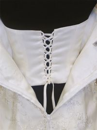 Anybody know a good tutorial for adding internal corset to wedding dress?