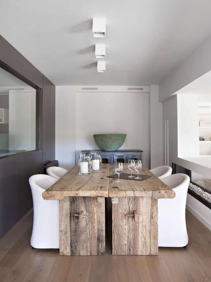 What caught my eye was the juxtaposition between the ultra modern and extremely rustic... I love a beautiful table, and I don't know that this qualifies in the same way as my polished rosewood, but... it did catch my eye.