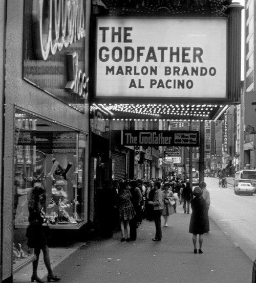 I swear this is the Warner Theatre in downtown pittsburgh. I saw the Godfather there. looks just like 5th avenue. Shoe store and all