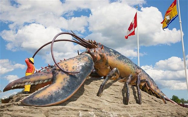The world's  largest lobster - Shediac, New Brunswick.. kids definitely had to have picture taken with this guy on our arrival to the beach