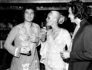 Lucio Battisti, Patty Pravo and Little Tony have a drink during a pause from Festivalbar music competition