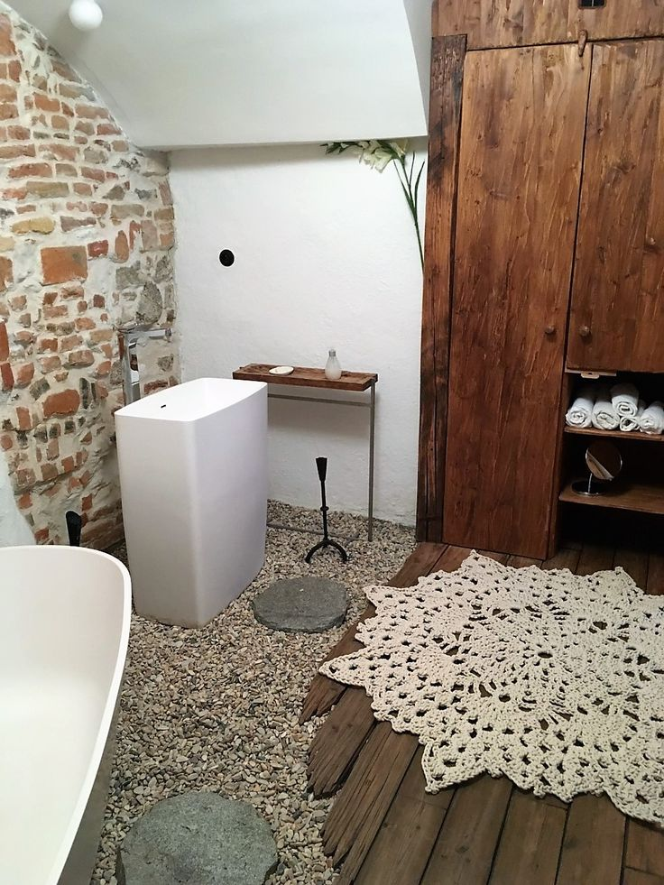 #homedecor .Unique  rustic bathroom with amazing old wooden floor combined with stones and like a cherry on a cake - a beautiful rope carpet by merleholm.eu