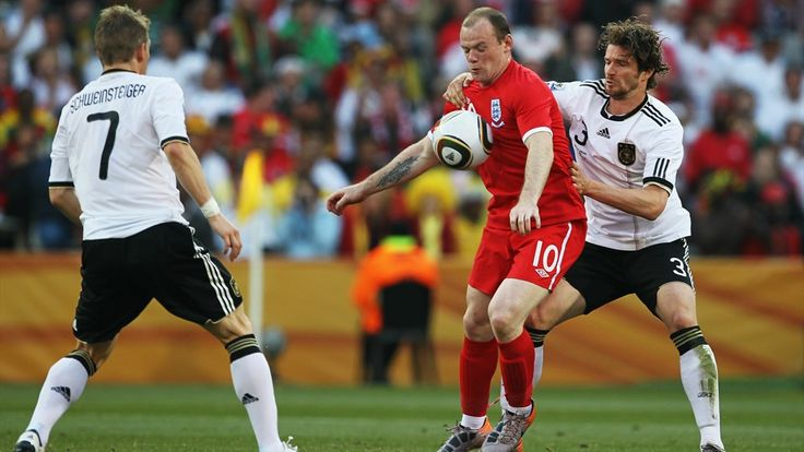 BLOEMFONTEIN, SOUTH AFRICA - JUNE 27: Wayne Rooney of England (C) controls the ball under pressure from Bastian Schweinsteiger (L) and Arne Friedrich of Germany (R) during the 2010 FIFA World Cup South Africa Round of Sixteen match between Germany and England at Free State Stadium on June 27, 2010 in Bloemfontein, South Africa. (Photo by Jamie Squire - FIFA/FIFA via Getty Images)