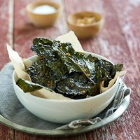 Baked Kale Chips are always one of our forgotten favorites. When we plow through a big bowl of kale chips, we're always reminding ourselves to make them again soon. But for some reason, this recipe gets buried under our pile of