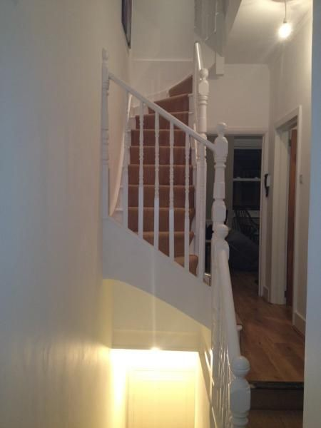 Best use of hallway space. Stairs this way around creates open feel & retains high ceiling (enables traditional ceiling clothes airer to be mounted above) Space is 'borrowed' from original stairwell, but sufficient head height is cleverly retained