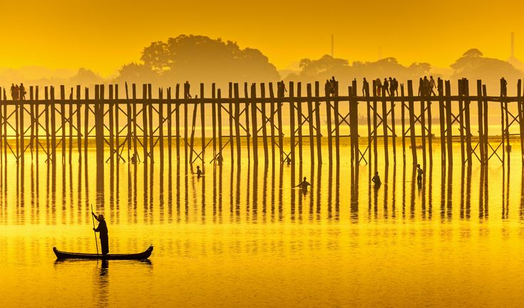 The U-Bein Bridge of Amarapura, just outside Mandalay. This is the longest wooden-bridge in the world, and perhaps the finest dawn view in Myanmar.