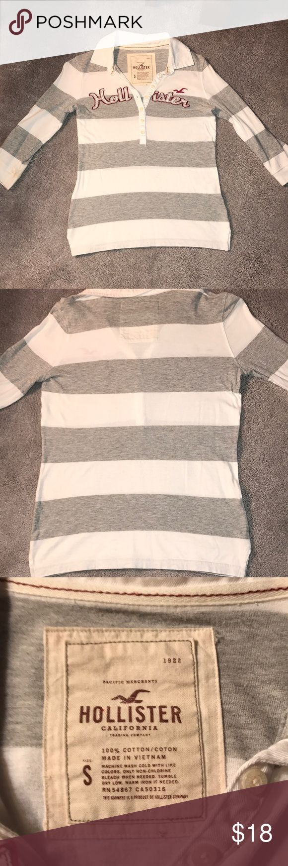 HOLLISTER RUGBY SHIRT GREY AND WHITE STRIPED This is a gray and white striped Hollister rugby shirt. It has not been worn very many times. There are no stains on it and it is a very nice shirt. It is a women's small. It is 100% cotton. Hollister Tops Tees - Long Sleeve