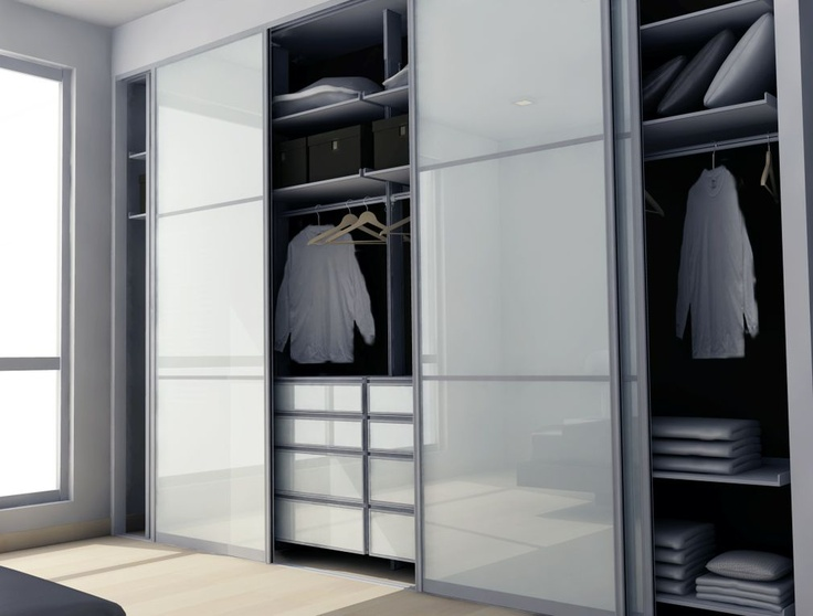 Custom modern closet with a combination of sliding doors, drawers and shelves