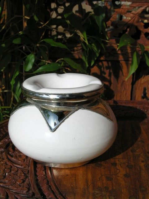 Small Moroccan ashtray with silver in white. http://www.maroque.co.uk/showitem.aspx?id=ENT06378&p=00739&n=all