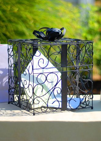Our best selling Reception Gift Card Holders will keep all your wedding day wishes and gifts wrapped up in high style! Both fashionable and functional, these unique reception accessories will not only keep your gift table under control, but theyll keep it looking fabulous as well! It can easily be incorporated into any wedding day setting. These ornately structured card holders feature a scrolling vine pattern design and are topped with super chic gift bows! Facts and Features:  Measures 10…