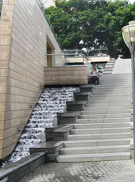 Water feature adjacent to steps water projects for Urban waterfall design