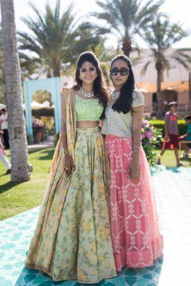 SIster of the Bride - Dhrumil & Anusha wedding story | WedMeGood | Bride in a Floral Lehenga with the sister in a Pink Net Lehenga with a Short Kurta  #wedmegood #Indianbride #sisterofthebride #sisterofthebrideoutfit #lehenga #lightlehenga
