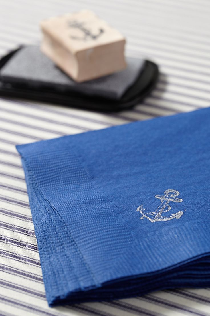 Anchor-Themed Napkins and Rubber Stamp. There are lots of little ways to bring your theme to the table.