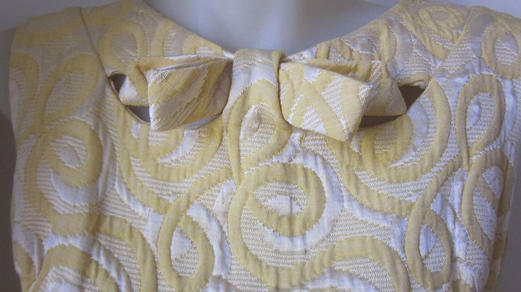 Parkshire Originals cute little Mod shift in buttercup yellow/cream swirls in sateen. Measures 28 inches around waist. 36 inches around bust. 40 inches around hips. Good vintage condition, no damage. Postage cost is basic snail mail, 6-8days., no tracking, so no record kept. If you want Express satchel with tracking, 2-3 days, that will be $10.50, just let me know before paying