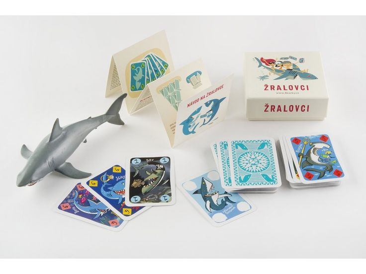 Žralovci. Nejnovější hra od 4 Kavek. Žralovci jsou žraločí lovci, krabička obsahuje 36 karet, se kterými jde hrát 8 různých klasických karetních her. Žraločí bitva Blázinec Černý Petr Záchod Domeček z karet Švindl Vole padni! Sexteto
