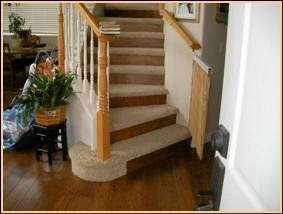 Custom Staircase With Carpeted Treads And Wood Flooring Risers.
