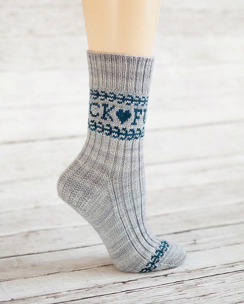 Pretty socks that say F@CK ♥ F@CK ♥ in a loop around the cuff.
