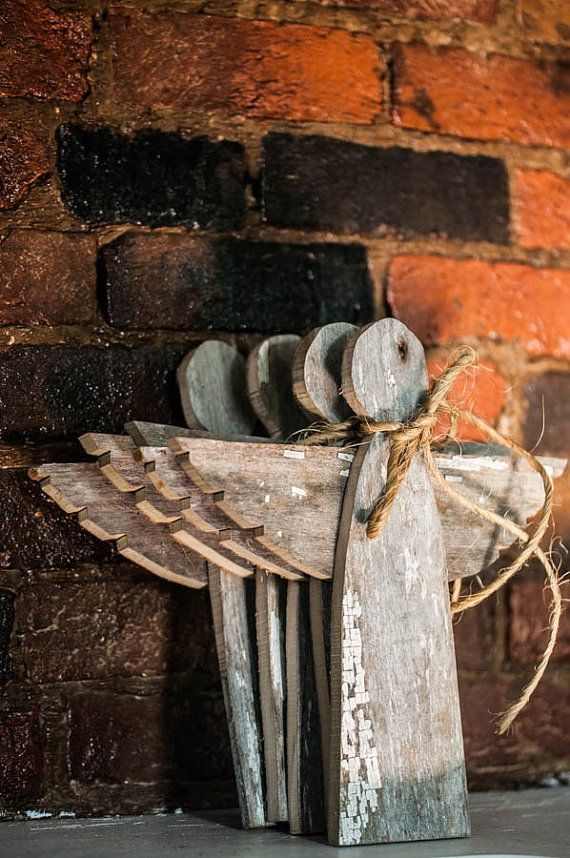 These beautiful wooden angel Christmas tree toppers are made from reclaimed wood. The rustic look of each angel has so much character and will bring so much rustic charm to your Christmas tree!  Each piece of wood is hand cut and nailed into place to create these very unique decorations. The back has a genuine leather circle attached in order to place atop your Christmas tree. The leather was taken from a local Amish workers scrap pile. Each angel has bailing twine used to decorate the…