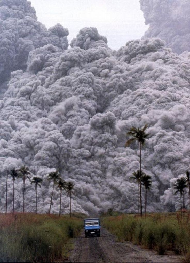 Rushing away from the erupting Mount Pinatubo, Phillippines (1991)