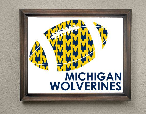 This colorful University of Michigan Wolverines Football print is an original pattern, designed with the University of Michigan Wolverines colors and symbols in mind. This print come in a variety of sizes (please see drop down menu on the right).  This print can come with or without the words, Michigan Wolverines (please see drop down menu on the right).  This unique University of Michigan Wolverines Football print looks great by itself, or on a gallery wall with other prints. It would be a…