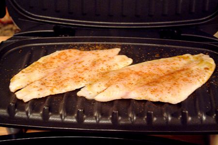 GRILLED FISH on George Foreman grill: ◾4 fish fillets  ◾4 tsp. olive oil  ◾salt  ◾pepper  ◾Old Bay seasoning  ◾Paprika  ◾½ lemon,  grill it, takes approximately 4 minutes.