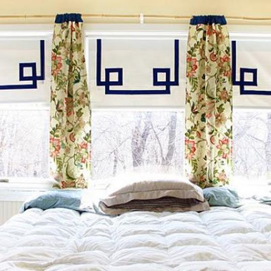 They added ribbon to inexpensive roller shades. All you need is ribbon and a glue gun - instant style. I want to do this for our guest rooms.