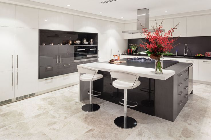 Kitchen with large central island with different heights designed and built by Urbane Projects, Perth.