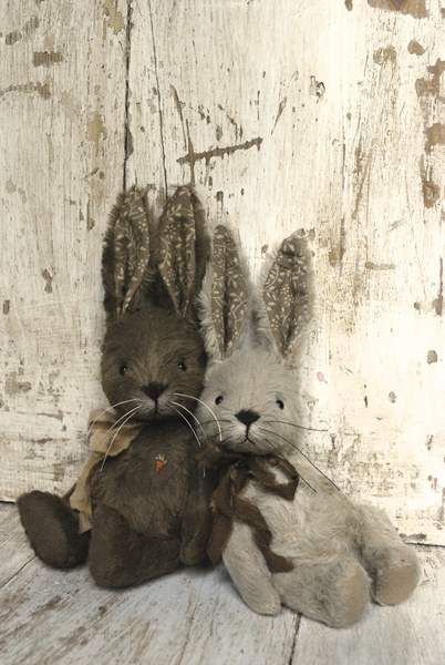 Two Little Rabbits wearing Bows ....