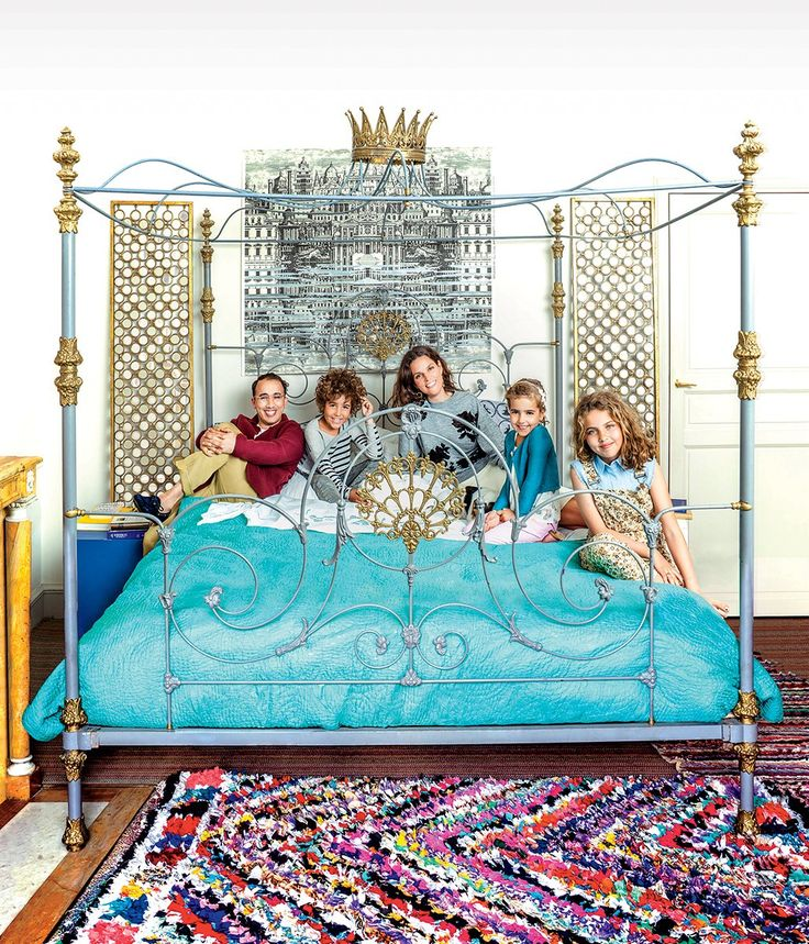 Victoire de Taillac-Touhami with husband Ramdane Touhami and their children, Adam, Noor, and Scherazade, in the master bedroom.