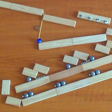Ingenious Rube Goldberg Machines Built from Magnets and Marbles