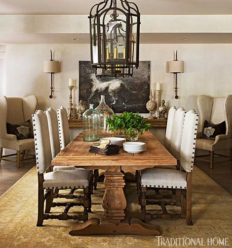 A farm table and iron details lend Old World sensibilities to this neutral dining room - Traditional Home® / Photo: Eric Roth / Design: Joseph Abboud in partner with RH