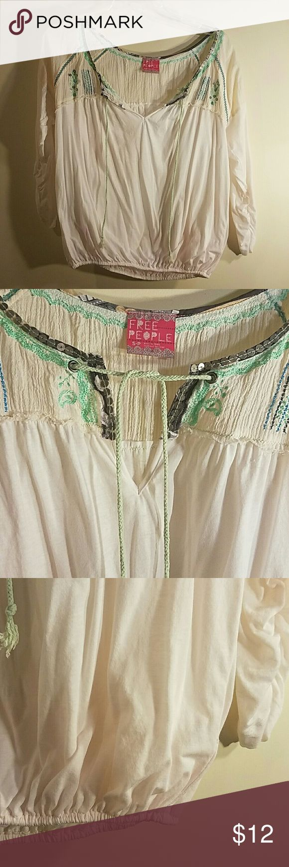 Free People Boho Top Good condition.  Perfect spring top.   Size S-P.  Has seemingly pink undertones.  But I do not believe from laundering.  ?? Free People Tops Blouses
