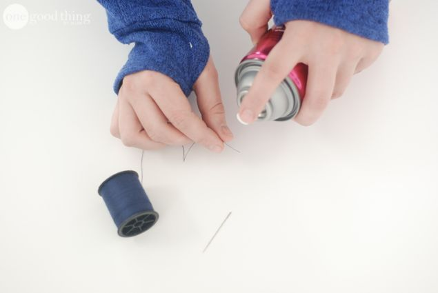 Spray the tip of your thread before running it through a needle.
