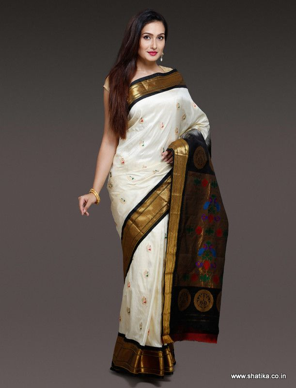 Glittering looks of Subhadra White And Black Paithani Silk Saree is unmatchable for its lovely combination and bright appearance. Make it yours now to be left out from owning a masterpiece woven by hands just for you.
