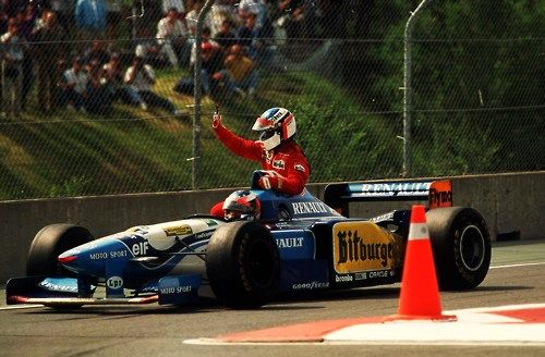 Jean Alesi gets a lift from Michael Schumacher after winning the Canadian Grand Prix of 1995.