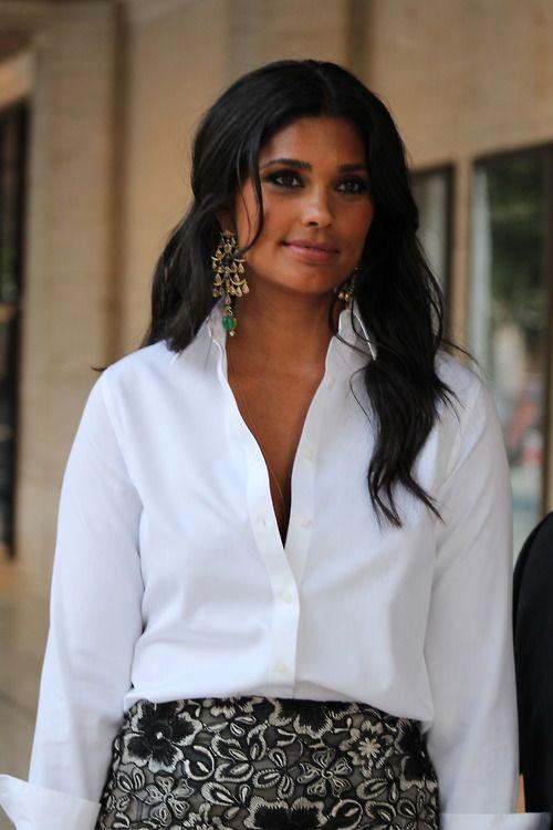 Glam earrings, a crisp white shirt, and a bold print skirt. Killah.