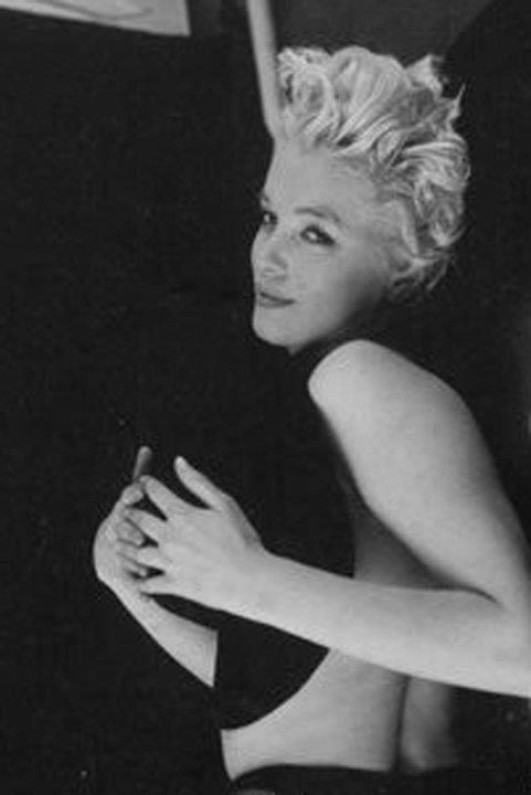 Marilyn Monroe. Black sitting. Photo by Milton H. Greene, 1956