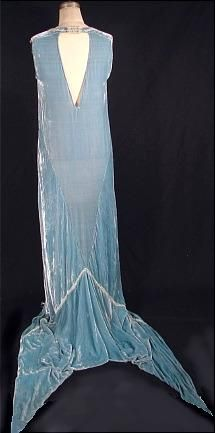 """rear view, c. 1924 CALLOT SOEURS, Paris Evening Gown in """"Callot-Blue"""" (a color created by the Callot Soeurs) silk velvet embroidered w/ a signature """"ribbon & bow"""" of silver & seed pearls & accented w/ dramatic double train (like a dragon's forked tongue), a favorite Callot feature"""