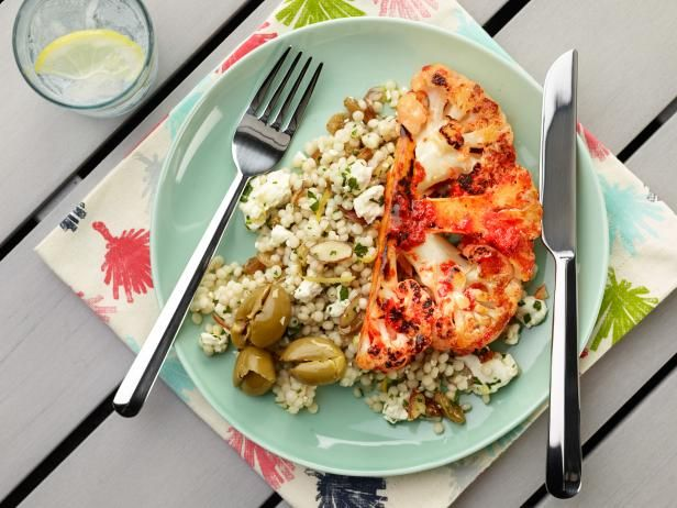 Get Grilled Cauliflower Steak with Israeli Couscous and Olives Recipe from Food Network