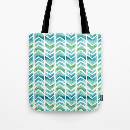 """Watercolour Chevron Pattern Design by Hazel Fisher Creations. Our quality crafted Tote Bags are hand sewn in America using durable, yet lightweight, poly poplin fabric. All seams and stress points are double stitched for durability. Available in 13"""" x 13"""", 16"""" x 16"""" and 18"""" x 18"""" variations, the tote bags are washable, feature original artwork on both sides and a sturdy 1"""" wide cotton webbing strap for comfortably carrying over your shoulder."""