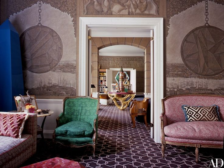 The London home of newlyweds Kata and Ashley Hicks showcases the latter's creative vision, from the living room's hand-painted mural of Constantinople to the chain-link-motif carpeting; Ashley also made the golden table in the mirrored bedroom niche beyond and the obelisk atop it.