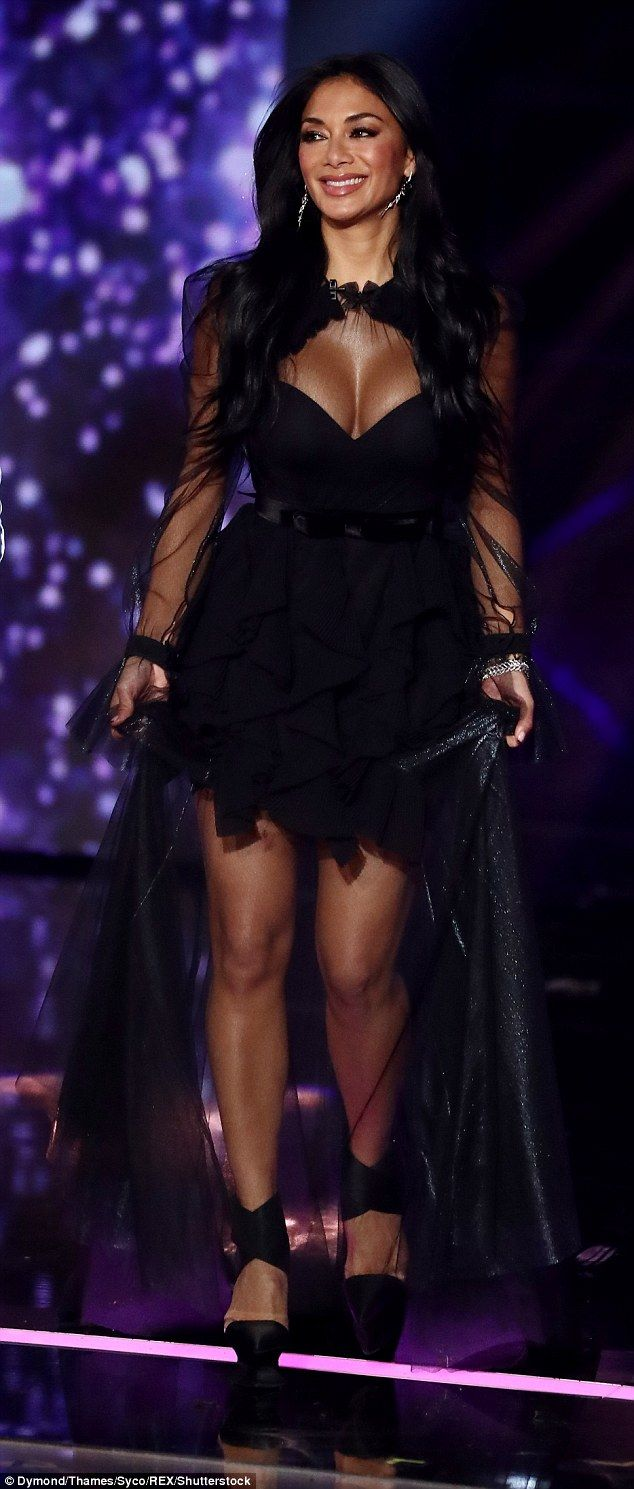 Bombshell: Nicole Scherzinger wowed as she put on a very busty display in a black dress wi...