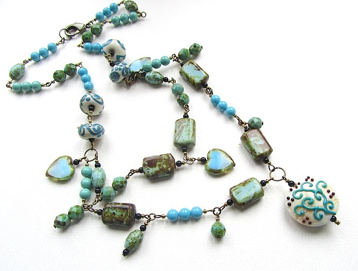 Alternative colourway for 'Glowing Treasures' put together as a symmetrical necklace because not everybody is as keen on asymmetry and randomness as I am! Lampwork beads by Tan Grey