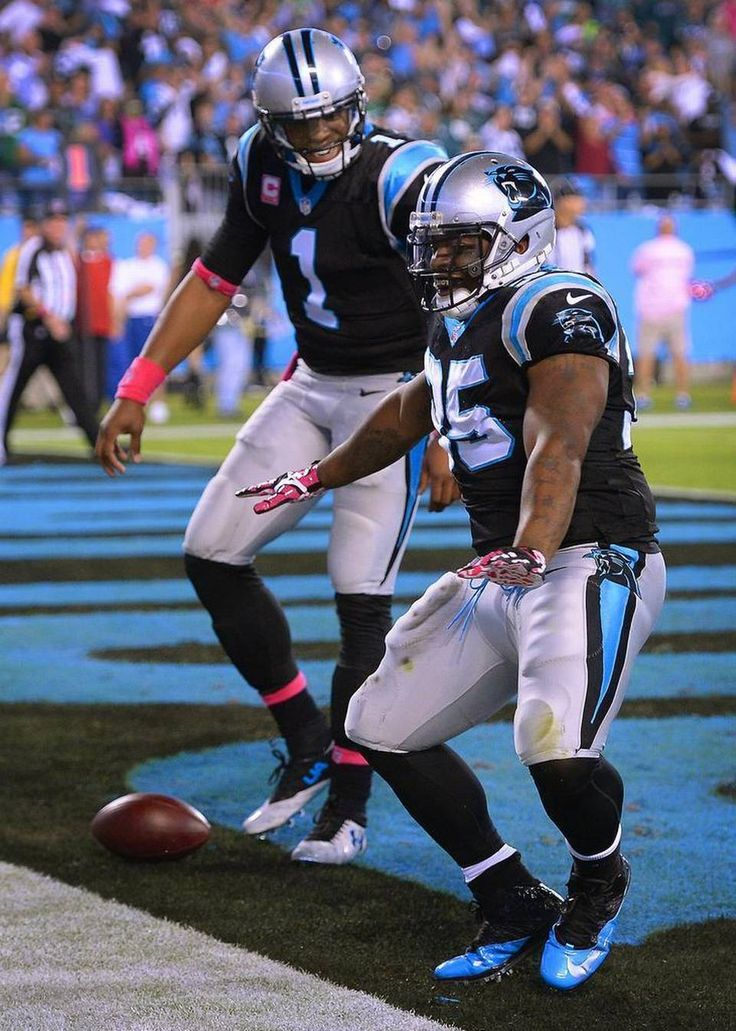 Carolina Panthers full back Mike Tolbert dances in the end zone following his touchdown run vs the Philadelphia Eagles as quarterback Cam Newton smiles during first quarter action at Bank of America Stadium in Charlotte, NC on Sunday, October 25, 2015.