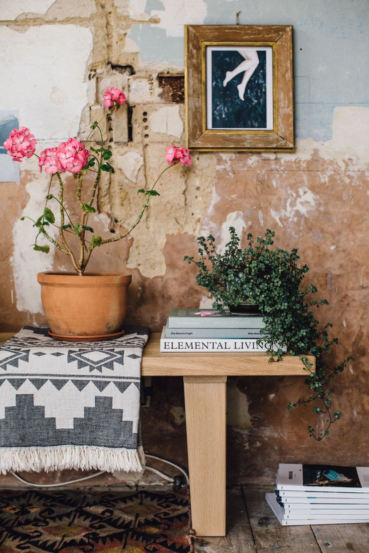 Eclectic bench styling in a Bohemian home with crumbling plaster walls.
