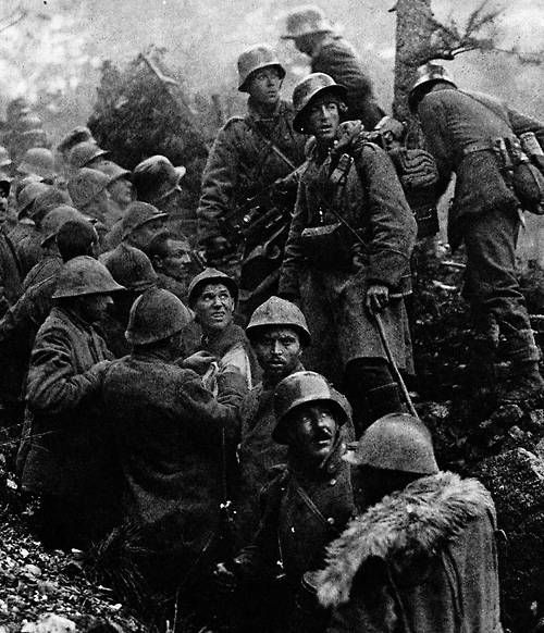 German soldiers with Italian POWs after the battle of Caporetto, 1917