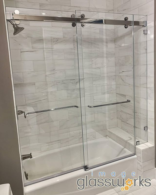 Very Sleek Crl Cambridge Frameless Bypass Sliding Door With An Inline Panel On Top Of The Seat Custom Design Frameless Shower Doors Sliding Doors Shower Doors