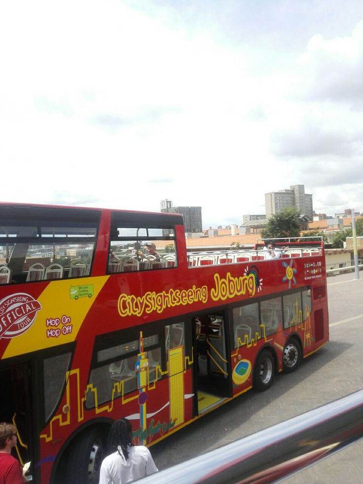 Hop on the City Sightseeing Red bus